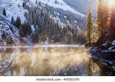 Morning after the first snowfall on the lake Kolsai, Tien-Shan mountains, Kazakhstan