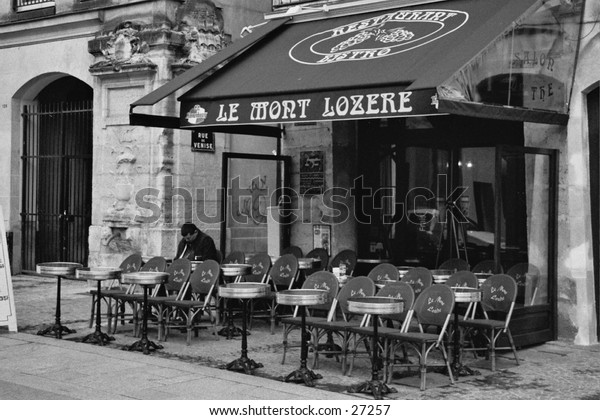 The morning after May Day at a street cafe in Paris