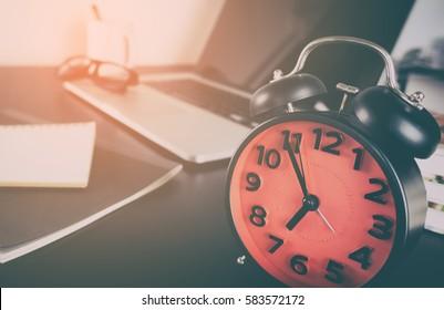 Morning Alarm clock on computer office desk