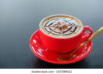Morning art cappuccino coffee on table and light background
