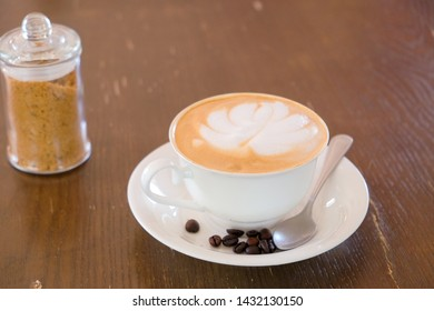 Morning art cappuccino coffee​ and roasted coffee​ bean​ on table