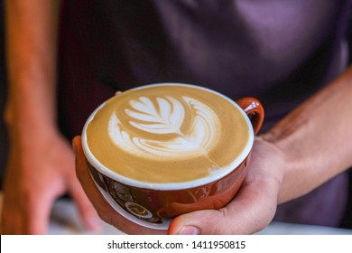 Morning art cappuccino​ coffee on hand