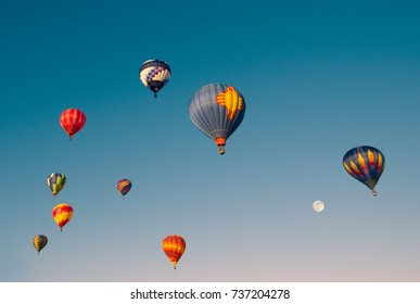 Morning Assent. Hot air balloon ascending in the early Morning.
