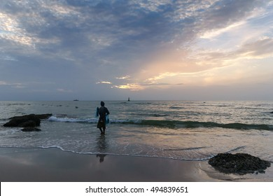 Morning at the beach with fisherman