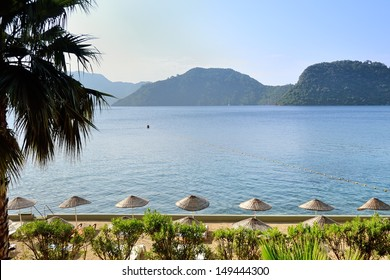 morning beach and scenic views of sea and mountains at Marmaris resort