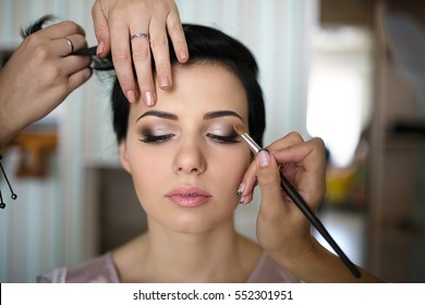 Morning beautiful delicate pleasant love bride fees happy bride on wedding day, make-up and hairstyle future wife