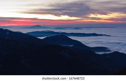 Morning before the sunrise above the low clouds viewed from Velika planina mountain plane in Slovenia