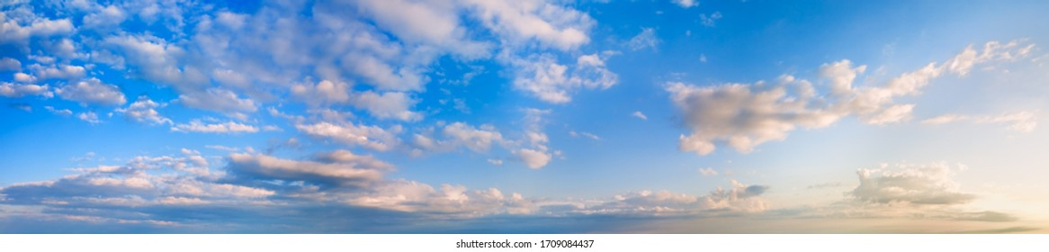 Morning blue sky panorama background with cumulus clouds.