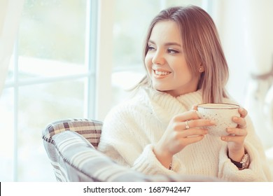 morning breakfast in a bright cafe, a cozy portrait of a young model, lifestyle at home