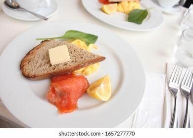 Morning breakfast meal.bread, salmon, scrambled eggs.