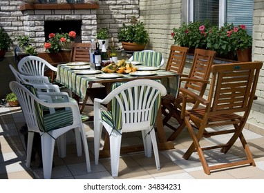 morning breakfast on the sunny terrase with fruits and wine