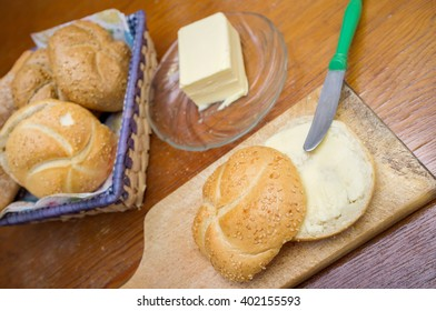 Morning breakfast. Small round loaf layered with butter.