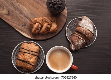 Morning breakfast with sweet pastries selection.