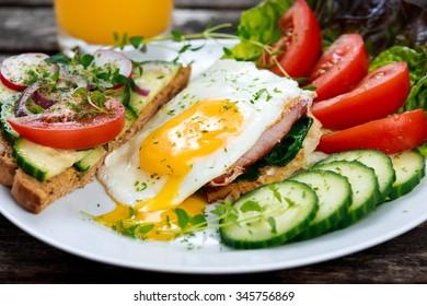 Morning Breakfast - vegan toast sandwich, egg, bacon, and vegetables