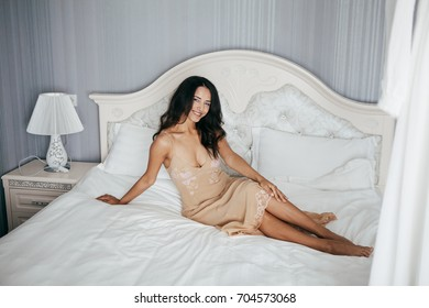 Morning bride beautiful girl in lingerie on bed