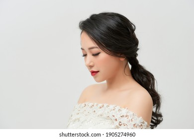 Morning of the bride. A beautiful bride stands in a wedding dress. Profile. Dress with lace