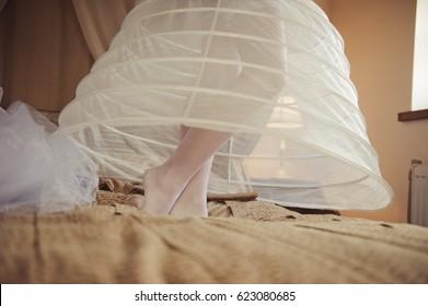 Morning of the bride. Bride in a petticoat