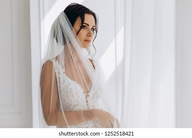 Morning of the bride. Portrait of a bride in a white dress.