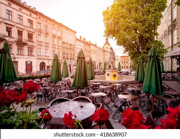 morning cafe in old european city after rain