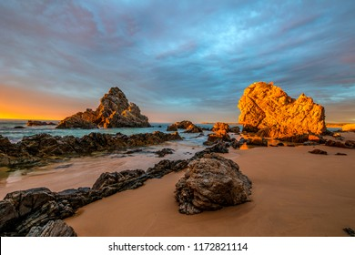 Morning camel rock surf beach, A landmark on this famous beach near Bermagui on the far south coast of NSW Australia, with beautiful rocks a sandy beach great for surfing, fishing or just relaxing.