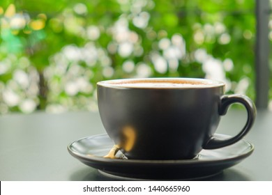 Morning cappuccino coffee​ and bokeh​ ​nature background