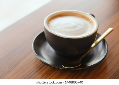 Morning cappuccino coffee​ and black cup