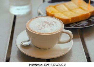 Morning cappuccino coffee and bread