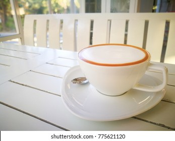 Morning cappuccino on white table