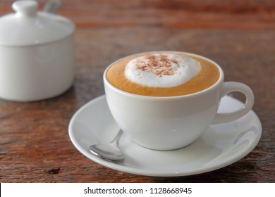 Morning cappuccino coffee on vintage wooden table
