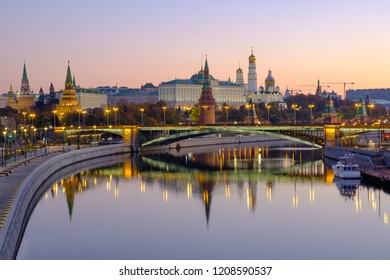 Morning city landscape with view on Moscow Kremlin and reflections in water of river.