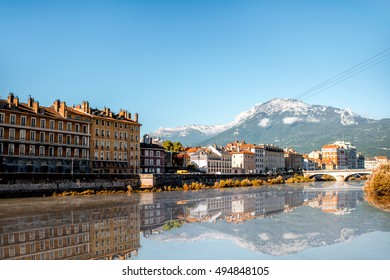 Morning cityscape view with mountains, river and bridge in Grenoble city on the south-east of France
