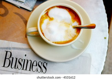 morning coffee and business section of the newspaper