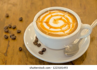 Morning cappuccino coffee with caramel sauce