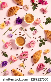 Morning coffee, croissants and a beautiful flowers . Flat lay st