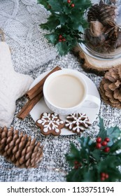 Morning coffee in a cup. Christmas composition. Cup of coffee, anise star, christmas cookies. top view