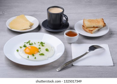 morning coffee, fried eggs with croutons cheese