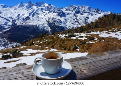 Morning coffee with the great view of Alpine Alps snow mountains at Saas fee, Switzerland