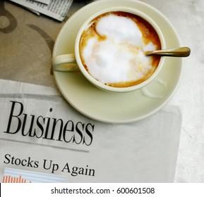 morning coffee and stock market newspaper headline