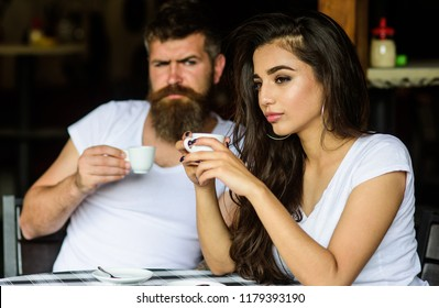 Morning coffee tradition. Couple enjoy hot espresso. Having black cup of coffee when feel tensed or low can boost your mood instantly make things better. Couple drink black espresso coffee in cafe.