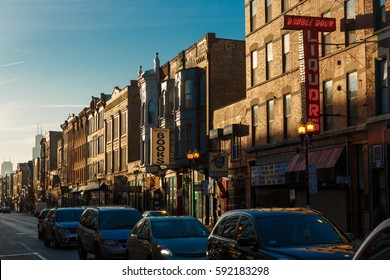 The morning commute begins as the sun rises over Chicago's Wicker Park / Bucktown neighborhood and North Milwaukee Avenue, on February 17, 2017.