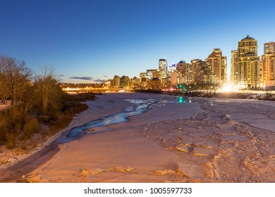 Morning commute hour in Calgary, Alberta with a view of the frozen river