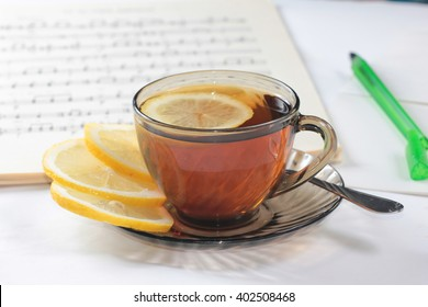 Morning cup of black tea with a slice of lemon