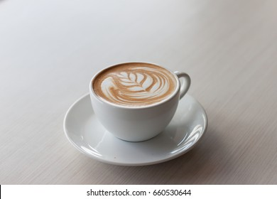 Morning with a cup of coffee latte Tulip style. Art and craft coffee.