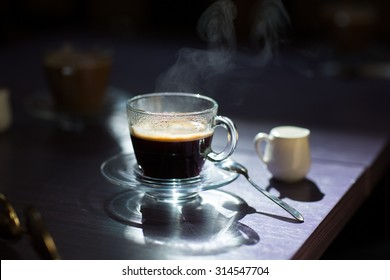 Morning cup of hot coffee on the table