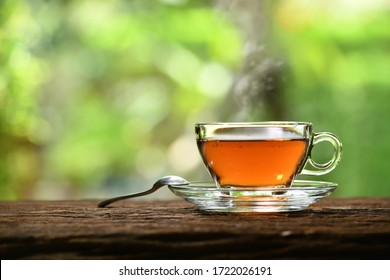 Morning cup of tea with smoke on nature background