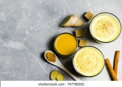Morning detox turmeric ginger drink on stone background. Top view, copy space.