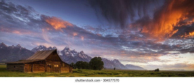 Morning drama in the skies above a Mormon Row barn in Wyoming's Grand Teton National Park.