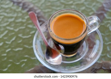 Morning espresso coffee on​ table