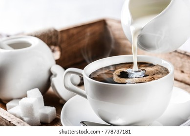 Morning espresso, Pouring milk to coffee, Cup of coffee and sugar