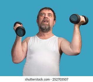 Morning exercises. Elderly man exercising with dumbbells